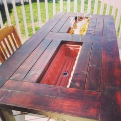 Table with built in ice buckets and drains. Genius! Build from (painted) reclaimed woodor pallets?
