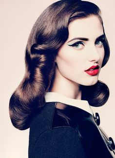 Stunning hair and makeup are the recipe for this retro look! #beauty
