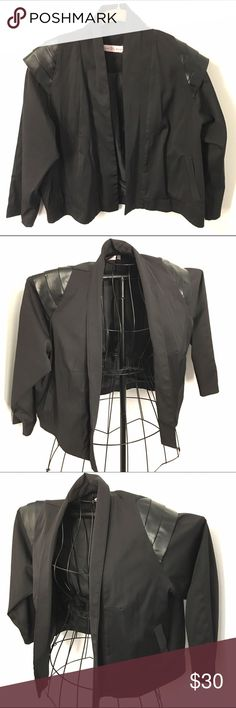 Vintage 1980s light jacket / blazer, L So cool. Such 80s style. The jacket is 70% poly, 30% wool. No front closures, so it hangs open, loosely.  Satin lined. All black. Pockets in front. Best part is the 3 tier Faux Leather embellishment on each shoulder. Gives the piece a very futuristic, space age look. There is a designer label in it, but it's in an unreadable font!  The word starts with a G and ends with a C, and there's a crown over the 2nd letter. If that helps. :) Jackets & Coats…