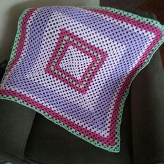 Traditional Granny Square yarn scrap blanket. Used left over yarn from the pink Sunburst blanket. :)