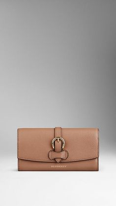 Burberry Dark sand Buckle Detail Grainy Leather Continental Wallet - Continental wallet in grainy leather with an equestrian-inspired buckle detail and foldover front.  Discover more accessories at Burberry.com