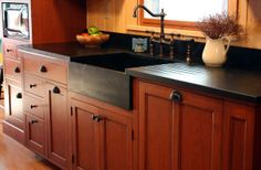 Soapstone sink and counters. Stained Cherry with glazing. Dull conversion varnish finish.Via Fire Wood Working.