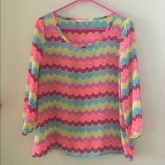 Peach Love Cream Top Bright and cheery chevron blouse. Excellent condition Peach Love Cream Tops Blouses