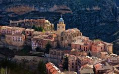 Sunset orange: the pretty village of Albarracín, in the Aragon region, is on the slopes of a mountain and is almost completely surrounded by...