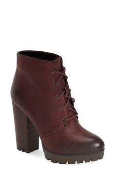A tall, chunky stacked heel and sleek leather put an uptown-chic spin on a lace-up bootie. @Nordstrom