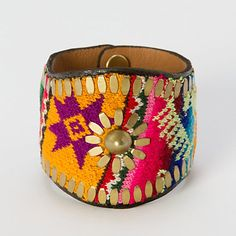 La Paz Cuff $215.00 - colorful fabric sourced from a vintage Bolivian hat. Handcrafted from supple Italian leather and brass hardware by Calleen Cordero. Nice <3