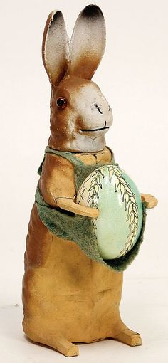 Easter Bunny, Paper Mache Candy Container, with egg in apron 22 cm.