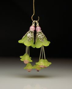 One matched pair of handmade bead dangles made from matte light green lucite flowers accented with little dangling green flowers with pink glass bead centers Size - wide by long Metal - Antiqued Silver Lucite Flower Earrings, Beaded Earrings, Beaded Jewelry, Wire Jewelry, Flower Jewelry, Handmade Beads, Handcrafted Jewelry, Beads And Wire, Jewelry Crafts