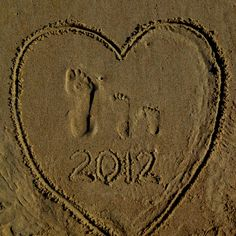 Mommy and kid footprints in the sand