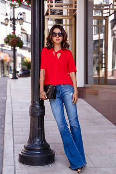 flared jeans with red top