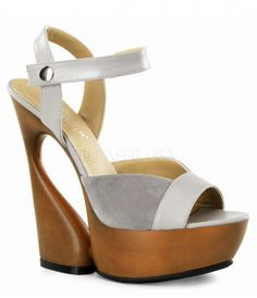 These taupe and wood heels have a great retro flair! They have an ankle strap with an adjustable snap closure. The heel is six inches with a platform that boasts fantastic cutout detail. <BR><BR>Please note all shoes have a 4 day handling time before they