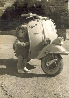 vespa | Tumblr-adorable, I want my kid to inherit my vespa one-day, when I own one..and I want her to be on mommy's lap while we go for a slow ride around the park..as I tell her tales of my upbringing and God's magnificence...