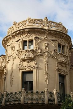 Palacio de Longoria, 1902, Madrid. Chosen for the round shape of the building itself along with the railings and delicate features of the molding. The accent of the square windows.