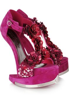 this is all kinds of crazy mixed into one futuristic heel.  we're talking suede, enamel, hot pink and a horseshoe heel...all for half the price of a brand new fiat.   rock on alexander mcqueen. $7520