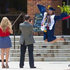 Laura Cline (BS #chemistry '16) jumps for joy to be a graduate. | University of Mississippi College of Liberal Arts