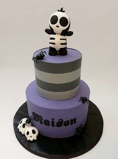 zombie cake by chocmocakes. im going to be sad if my child doesnt enjoy skulls like i do.
