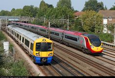 A London Overground service is passed by a high speed Virgin Trains Pendilino bound for London Euston on the West Coast Main Line.