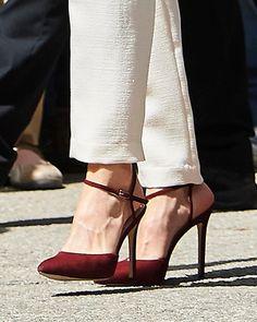 LODI burgundy suede ankle strap pumps.