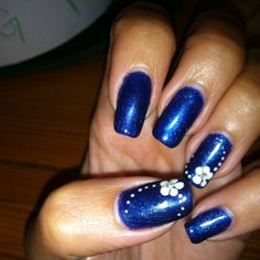 Navy Blue Nails with White Flower Accent Nails - Great with Jeans! Gelish Polish on Natural Nails  Metallic Navy Blue    White Flower Detail with Crystal Embellishment   By Jade Phuong's Nail Artist Team at Blackhawk Nail and Spa