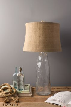Clear glass base lamp with natural fiber shade has rustic charm. From Surya. (LMP-1011)