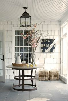 white shingle walls and bead board ceiling and windows, slate floor, black & straw accents