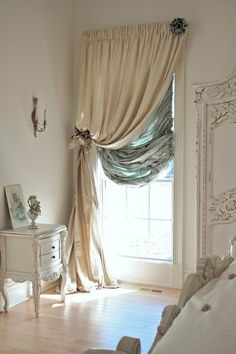 One draped curtain and a casual balloon blind underneath. Practical and elegant.