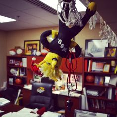 Day 1: Shocker on the Shelf gets caught on one of Gregg Marshall's nets in his office after stealing his favorite practice whistle.