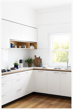 I LOVE simple TIMELESS white kitchens!!! White plywood Kitchen 1 | cantileverinteriors.com