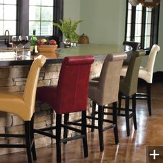 I love the stone bar and the multicolor bar stools.