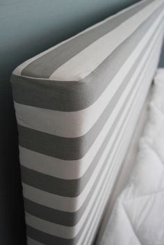 DIY Upholstered headboard... Different fabric and maybe have the buttons on it...