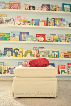 like the library shelves this would be good to do I have lots of books and baby will be reading...one day!!!