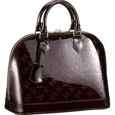 I love patent leather purses...and Louis Vuitton.