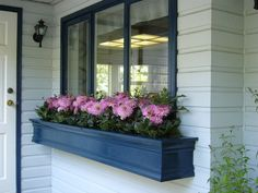 Put up a window box. You can paint it to match or contrast your trimwork and change out the flowers seasonally. In fall, fill with mums, pumpkins and oddly shaped gourds.