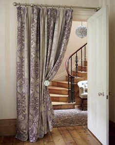 I adore curtained doorways!  I removed the doors from several rooms in my house to save the lost space the door was taking up. I even did it between the master bedroom and bath.  Worked beautifully.  No longer awoken by door opening/ shutting noises when (ex-)spouse got off work late at night.