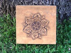 """This keepsake box features a Celtic styled lotus. The lotus is a sacred flower among most religions and is revered. Great for holding stones, tarot cards, or anything else you feel deserves this beautiful storage box. It is cigar shaped and measures approx 8""""x8"""". Stained 'golden oak' and sealed for protection. Hand made just for you!"""