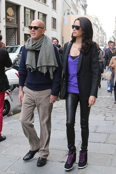 Parisian Getaway    This happy couple certainly has contrasting styles. Bruce Willis (in khakis and a cardigan) and his young wife Emma Heming (in black jeggings and sneakers) left their newborn at home as they strolled hand-in-hand in the Place Vendome in Paris, France.
