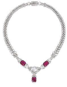 PLATINUM, RUBY AND DIAMOND NECKLACE Of geometric design, the front set with…