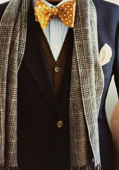 Checkers, polka-dot bow-tie, vest, jacket, scarf, and a pocket square. No detail overlooked.