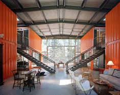 corrugated steel barn + 12 shipping containers + glass = sweet digs