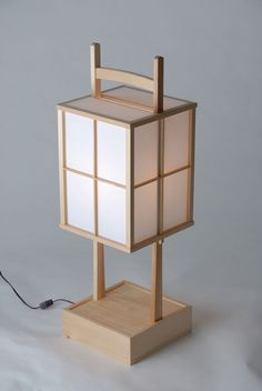 "The large andon (10"" x 10"" x 31"") is a finely crafted, box-like lantern made of natural white pine, hand-finished using a traditional Japanese plane. The rice paper is fortified with a plastic coating for extra durability. This lantern is constructed using tenon-mortise joinery--no nails are ever used! The power cord has an on/off switch near the base. Slide one of the panels up for easy bulb replacement. 40w bulb recommended. Item # A10-31"