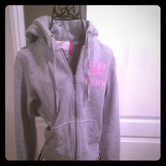 PINK by VS zip up hoodie grey with pink accents  This grey zip up hoodie PINK by VS was one of my daughter's favorites . It's showing some wear but is still super cute . Size S  PINK Victoria's Secret Tops Sweatshirts & Hoodies