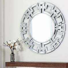 Grace your wall with this round wall mirror from Abbyson Living. This distinctive mirror features a unique glass/wood construction that will create a contemporary feel in your home. Easy to clean and maintain, this piece is practical and stylish.