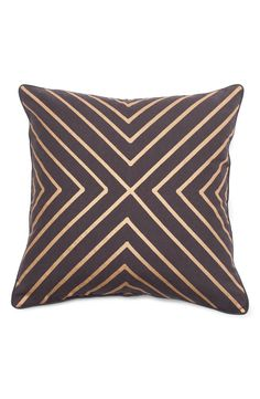 A modern chevron pattern lends a hint of golden gleam to this elegant accent pillow.