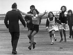 POW's return home from vietnam.