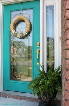 Looking for a fast and easy way to add a little curb appeal? Paint your front door! Love how @Sand and Sisal painted her door turquoise chalk paint.