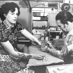 Vintage photograph of a woman getting a tattoo