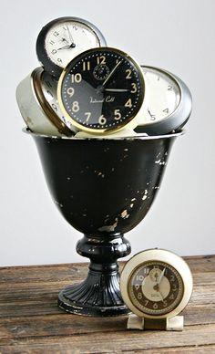 Chippy black urn with clocks