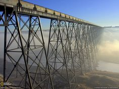 The Lethbridge, Alberta Viaduct is the largest railway structure in Canada, standing almost 100 meters high and over meters long. This morning it appeared to be skirted in a morning fog. O Canada, Alberta Canada, Canada Travel, Weather Wallpaper, Senior Student, Railroad Bridge, Railroad Tracks, Essay Writing, Writing Skills