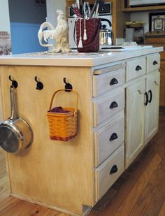 aww, this sweet lady refinished her 90's cabinets with a cheap rustoleum kit. amazing!