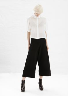 Designer collection: Black cropped culotte with a high waist. The flattering androgynous shape is paired well with a bootie and a structured coat. Made of 100% Merino wool. (Est. Price: $530.00)